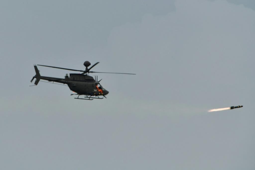 A US-made OH-58D Kiowa helicopter fires a Hellfire anti-armour missile
