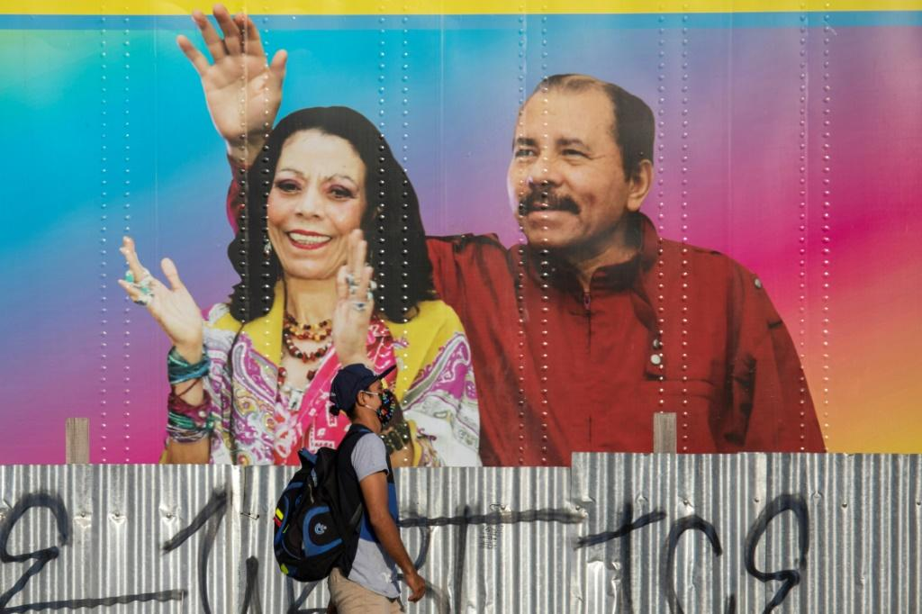 A man in Managua walks in April 2020 by a mobile health clinic displaying a picture of Nicaragua's President Daniel Ortega and his wife, Vice President Rosario Murillo, whose son Juan Carlos Trujillo has been hit by US sanctions
