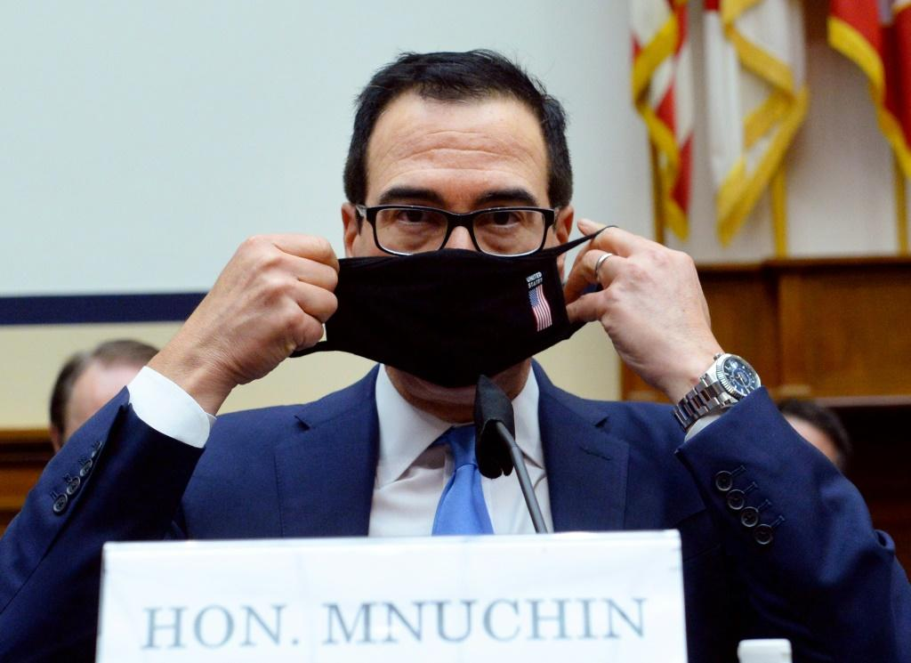 US Treasury Secretary Steven Mnuchin puts on his face mask after testifying before the House Small Business Committee