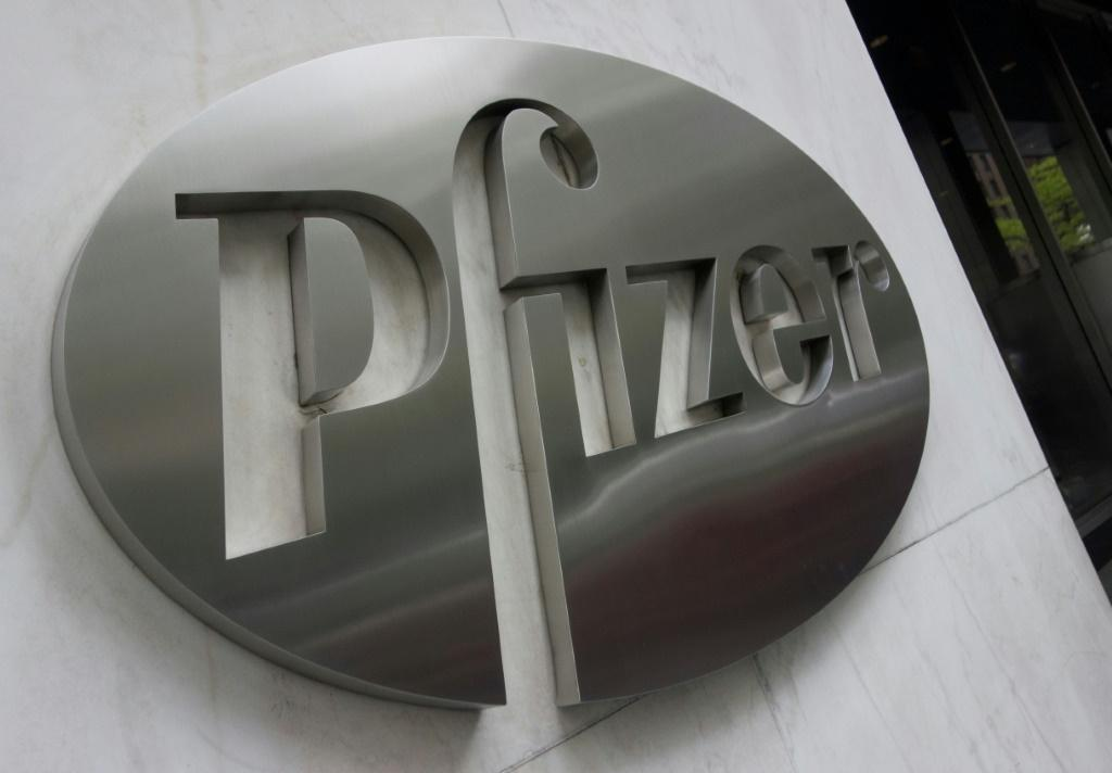 The Pfizer company logo is seen in front of Pfizer's headquarters in New York