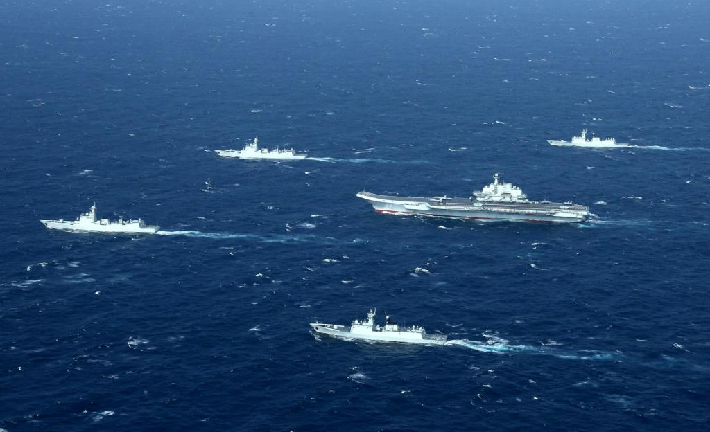 Chinese navy ships, including the aircraft carrier Liaoning, during military drills in the South China Sea