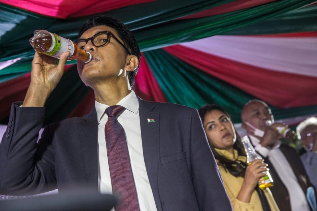 Madagascan President Andry Rajoelina launches 'Covid Organics,' a touted remedy for coronavirus, on April 20. Experts warn that claims for the drink have not been supported by science.