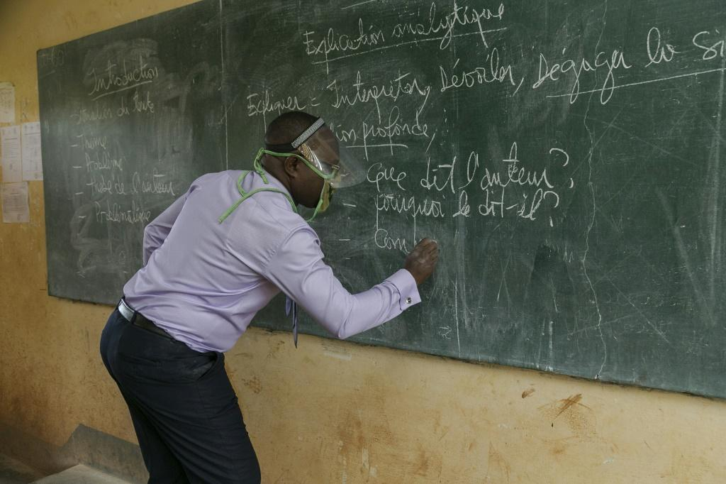 Protection: A teacher wears a face shield at the Nkol-Bisson Technical High School in Yaounde