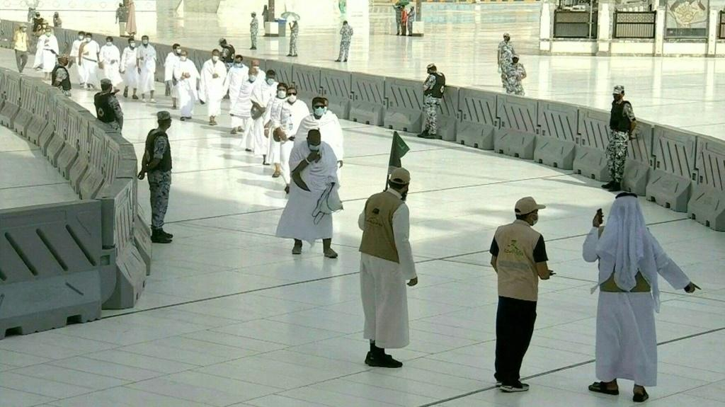 IMAGES The first groups of Muslim pilgrims arrive to Mecca's Kaaba as they begin the annual hajj, dramatically downsized this year as the Saudi hosts strive to prevent a coronavirus outbreak during the five-day pilgrimage.