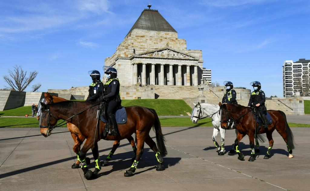 Police patrol Melbourne's Shrine of Remembrance to enforce rules requiring people wear masks