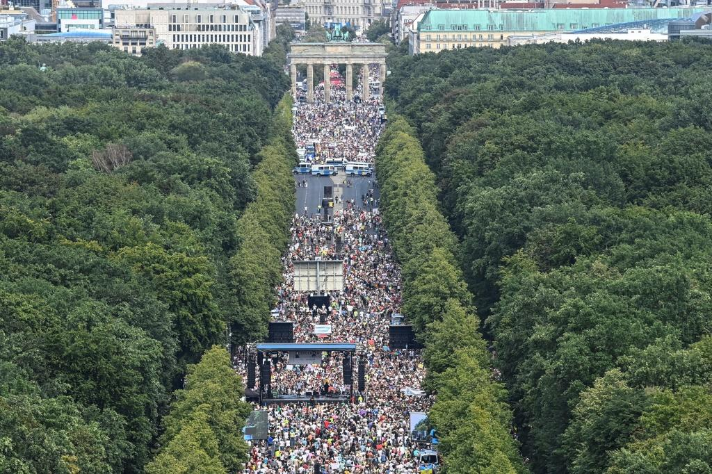 """Although infections have been creeping back up in Germany, some marchers say imposing rafts of restrictions amount to """"scare tactics"""