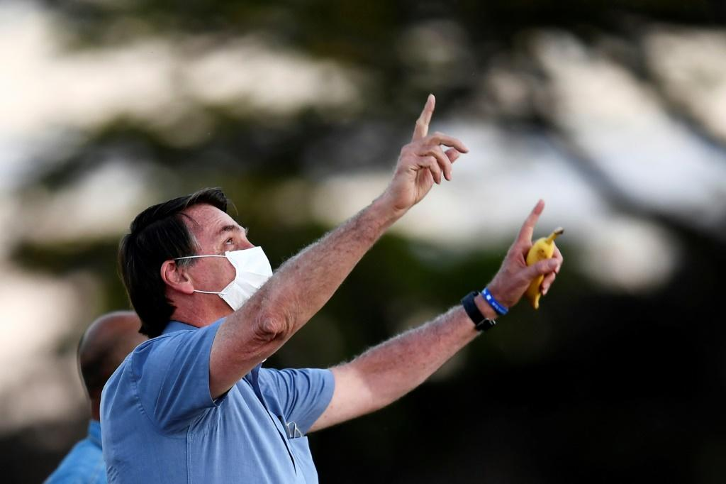 Fresh off a bout of COVID-19, Jair Bolsonaro urged Brazilians to 'face up to it' and said there was nothing to fear