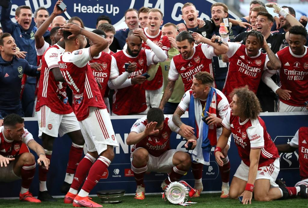 Pierre-Emerick Aubameyang (left) reacts after dropping the FA Cup