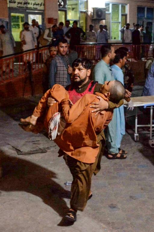 A man wounded in the bomb blast attack on a prison in Jalalabad city on August 2, 2020 is carried to the hospital