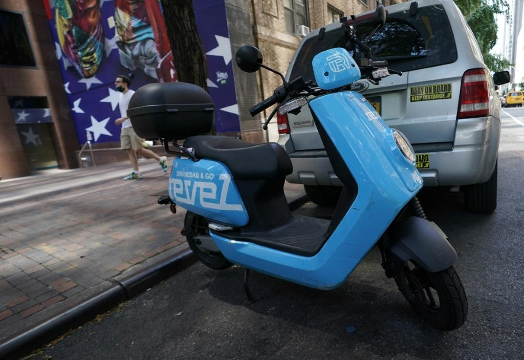 A Revel ridesharing moped is seen parked in midtown New York City July 28, 2020, after the company announced today it is suspending its service in New York City following the death of a second rider in Queens