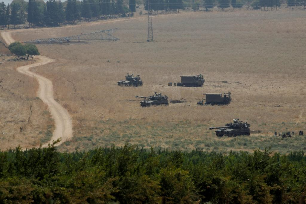 Armoured vehicles and 155 mm self-propelled howitzers are deployed in the Upper Galilee in northern Israel on the border with Lebanon on July 27