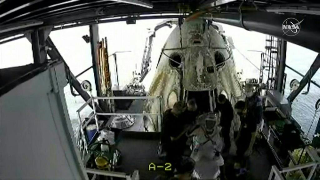 US astronauts exit space capsule after first splashdown in 45 years