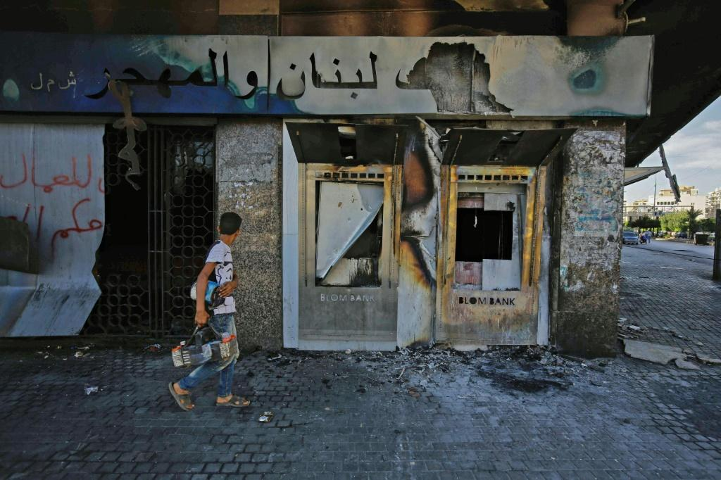 A burnt down branch of a Lebanese bank after it was vandalised by protesters in Lebanon's northern port city of Tripoli on June 12