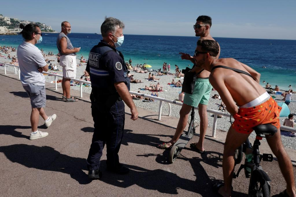 French police patrol to inform people that the wearing of a mask is mandatory in the French riviera city of Nice