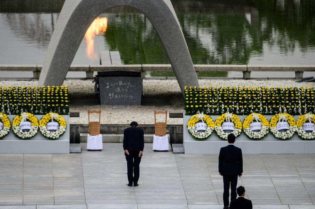 Japanese Prime Minister Shinzo Abe bows in front of the Cenotaph after delivering a speech during the 75th anniversary service for atomic bomb victims at the Peace Memorial Park in Hiroshima