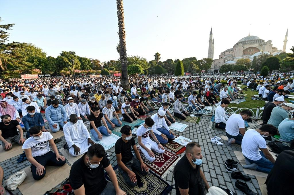 Worshippers take part in the Eid al-Adha prayers outside Hagia Sophia in Istanbul