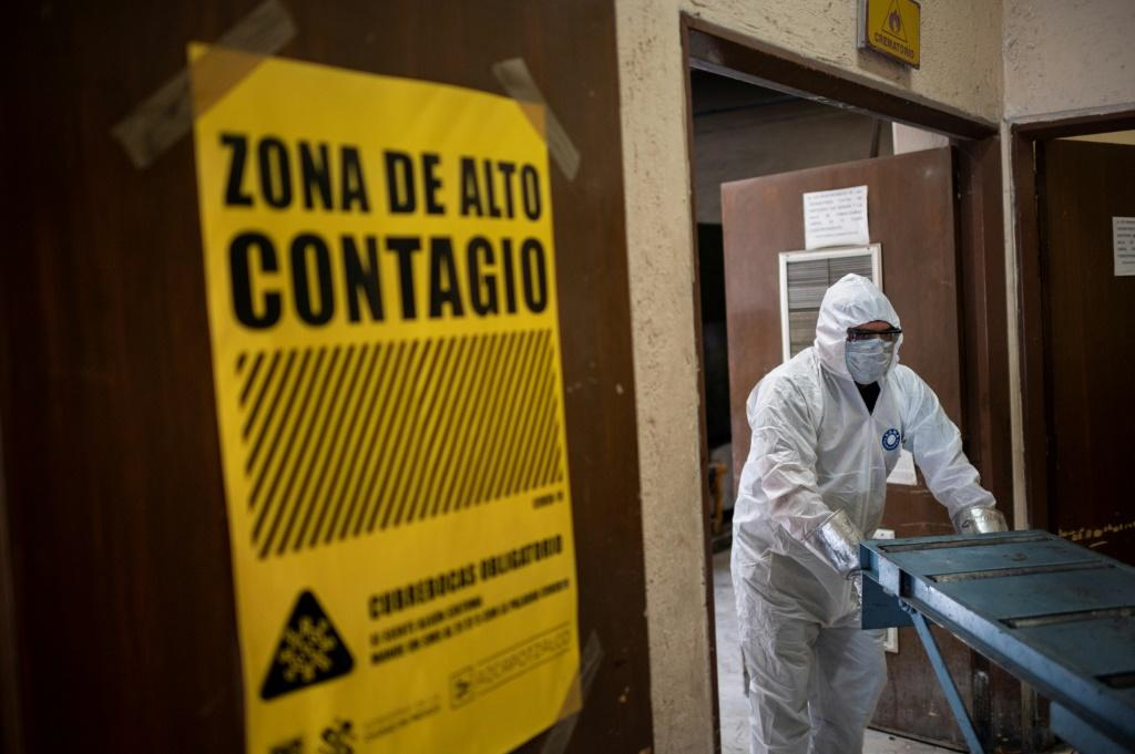 An employee wears protective gear while working at the Azcapotzalco crematorium in Mexico City, on August 6, 2020, amid the COVID-19 coronavirus pandemic