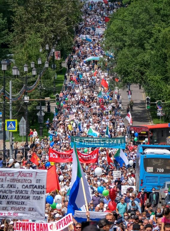 Protestors -- either 3,000 or up to 50,000 according to participants -- march through the Russian Far East city of Khabaraovsk to call for the reappointment of popular governor Sergei Furgal who was removed by Moscow