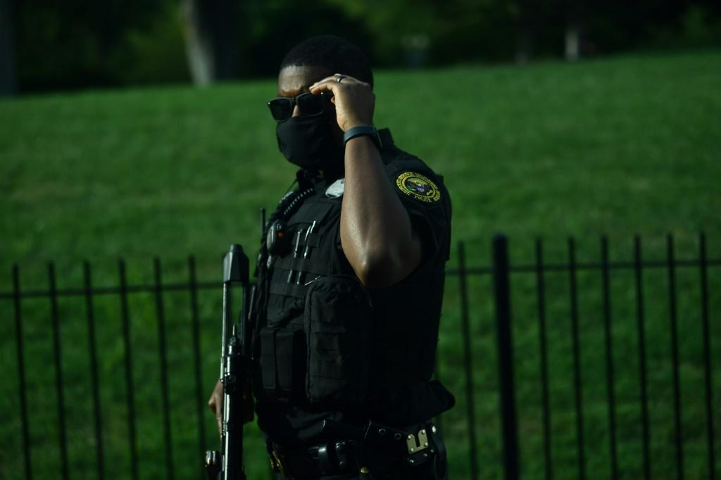 A member of the US Secret Service's counter assault team stands outside the Brady Briefing Room of the White House on August 10, 2020