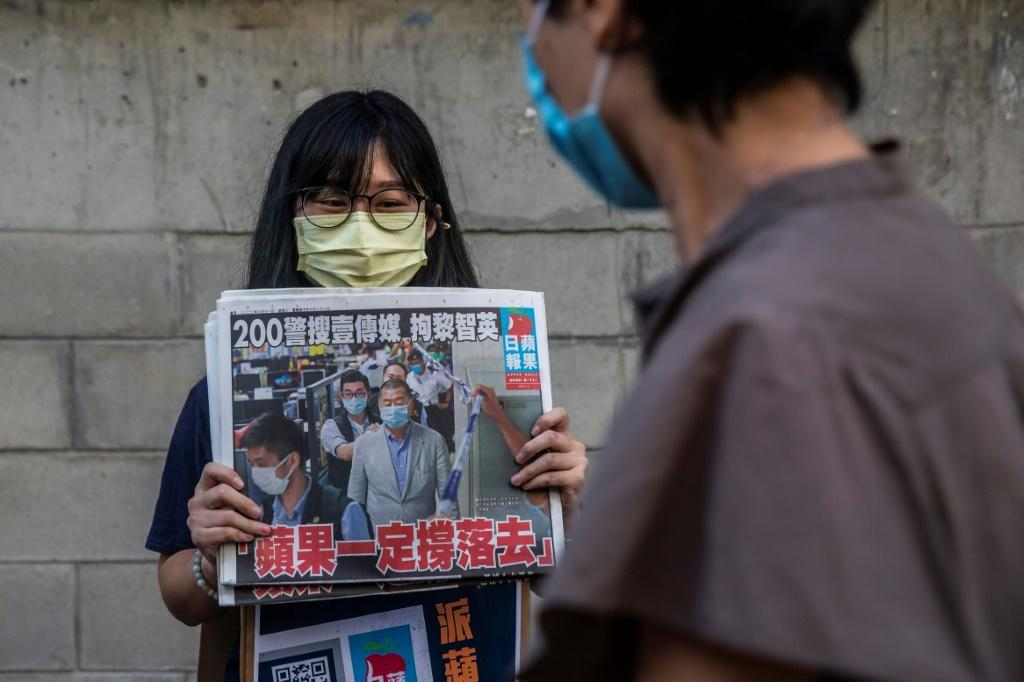 Hong Kongers bought copies of pro-democracy newspaper Apple Daily and shares in its parent company to voice support for its arrested owner