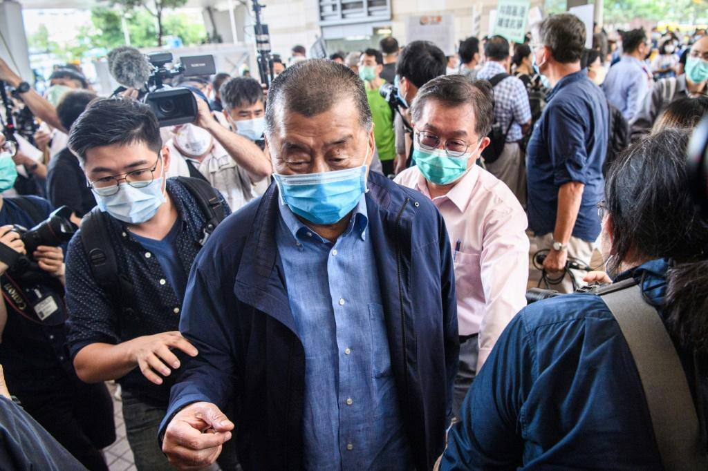 Jimmy Lai arrives at court on charges related to last year's protests