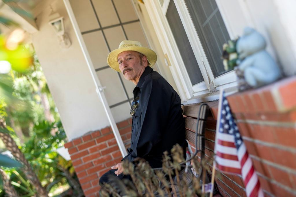 Joaquin Gutierrez poses in front of the house where he is renting a room in Van Nuys, California -- he says he may have to eventually return to his native El Salvador as the money has run out