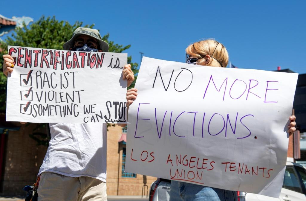 "The ""Cancel Rent"" protest and caravan made its way through Chinatown in Los Angeles, on the way to City Hall"