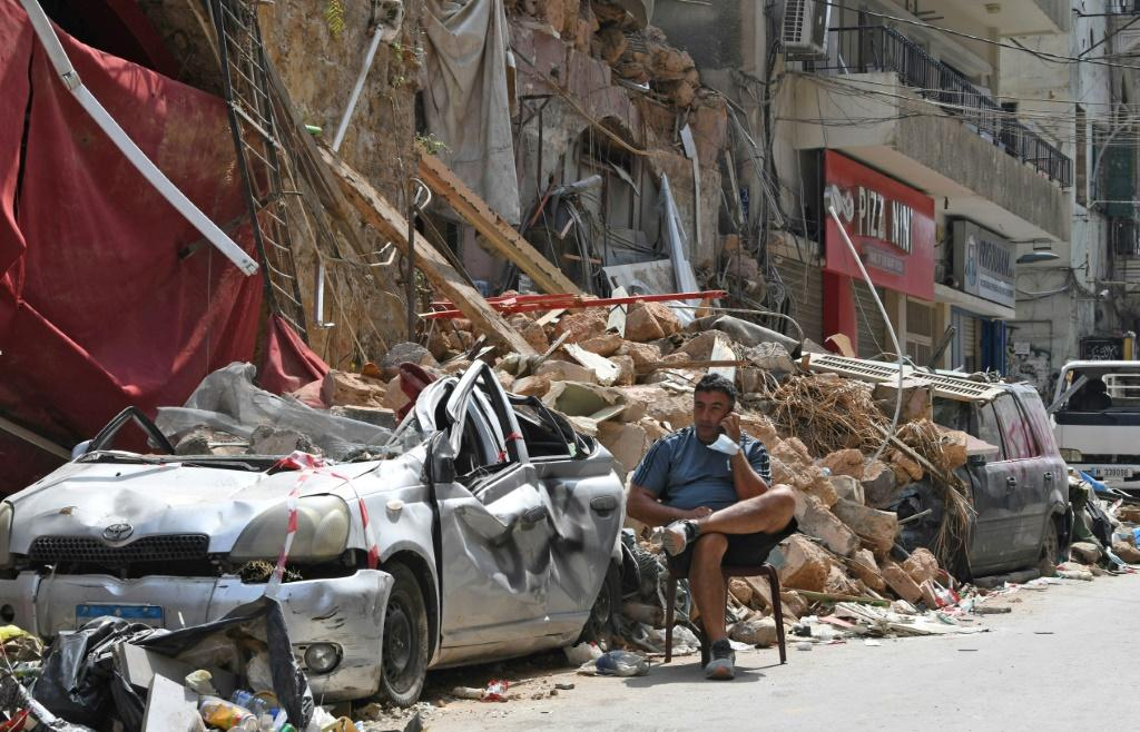 A Lebanese man amid the rubble of a traditional building in the Gemmayzeh neighbourhood following last week's cataclysmic port explosion which devastated Beirut