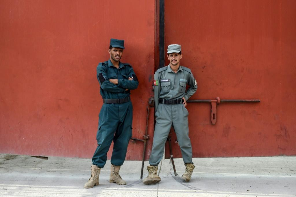 Security personnel stand guard at the prison where the Taliban prisoners to be released are being held
