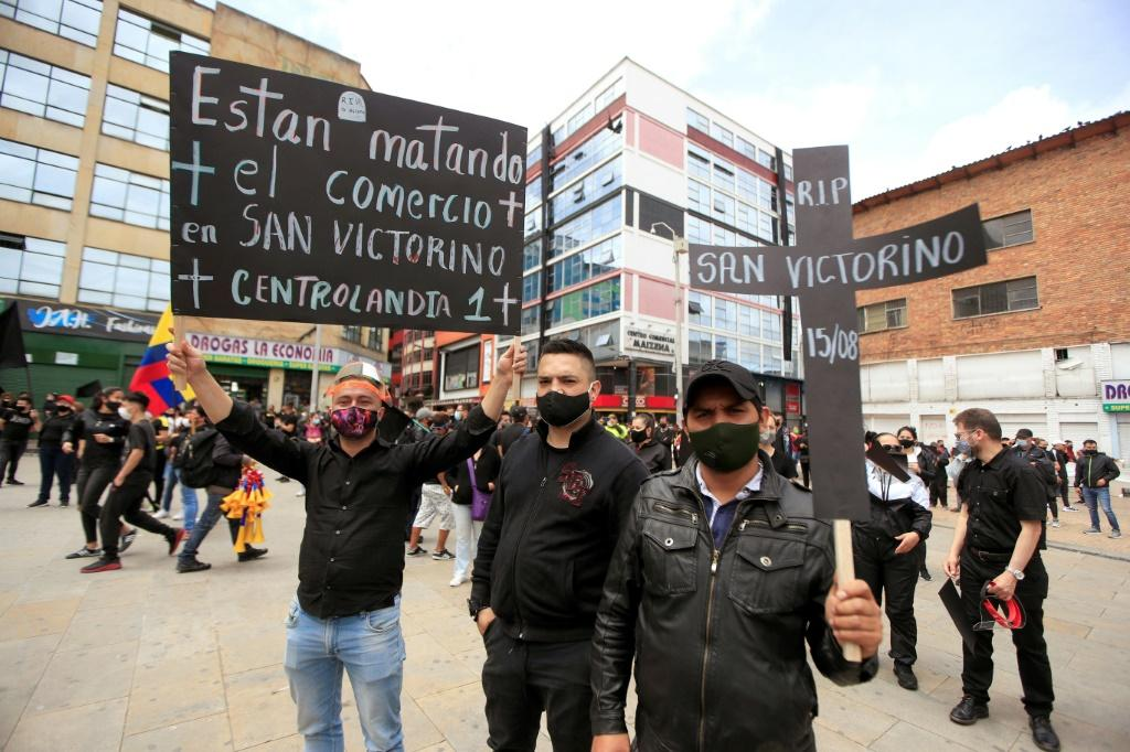 Merchants wearing black clothes and face masks staged anti-lockdown protests in Colombia