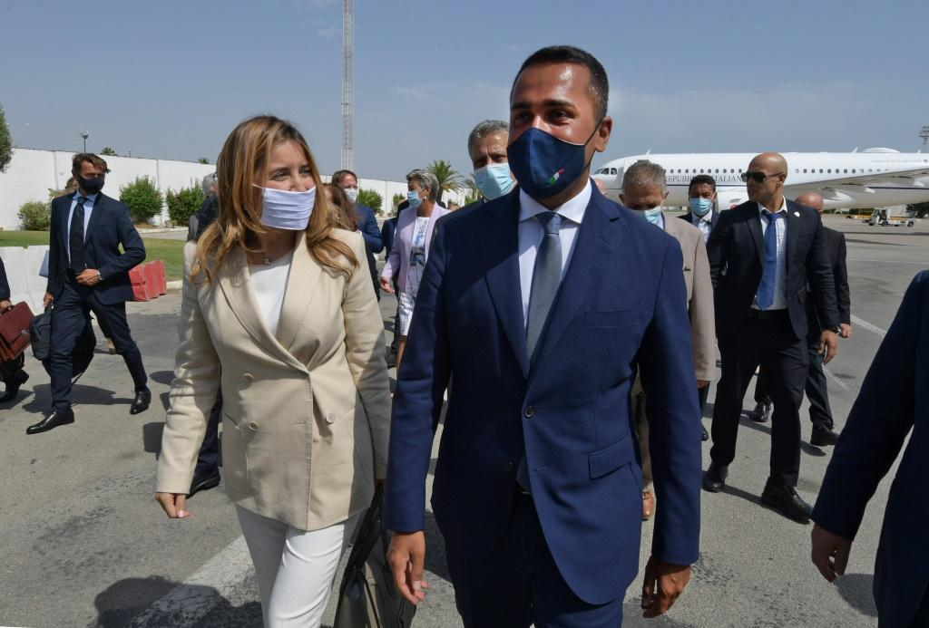 Italian Foreign Minister Luigi Di Maio (R) is welcomed on his arrival in Tunis by Tunisian Secretary of State for Foreign Affairs Salma Ennaiefer