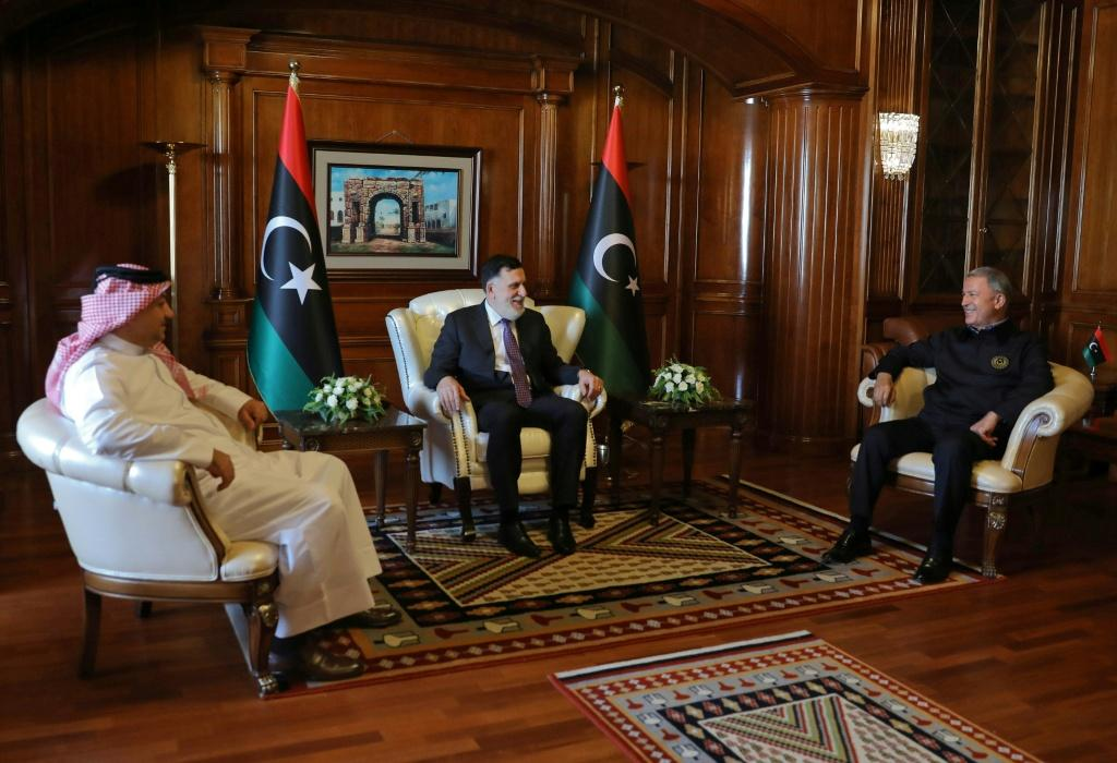 Prime Minister of Libya's UN-recognised Government of National Accord (GNA) Fayez al-Sarraj (C) meets with Turkish Defence Minister Hulusi Akar (R), and his Qatari conterpart Khaled bin Mohammad Al-Attiyah (L) in the capital Tripoli
