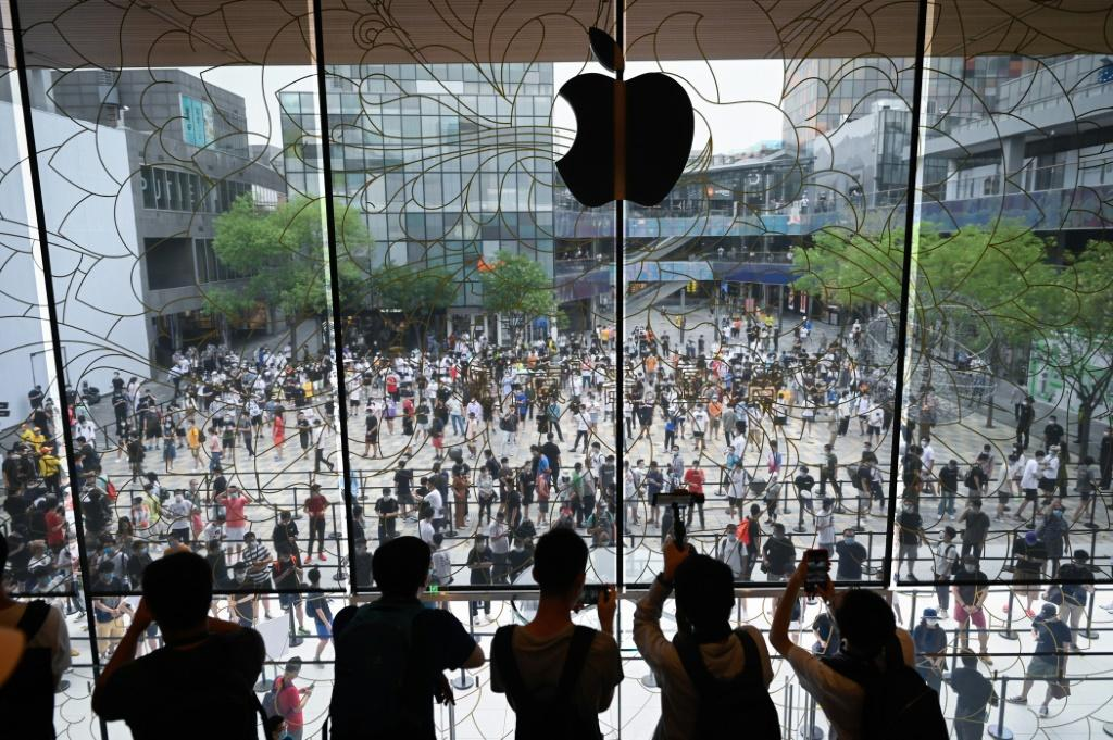 People queue up to enter a new Apple flagship store that opened in Beijing in July 2020
