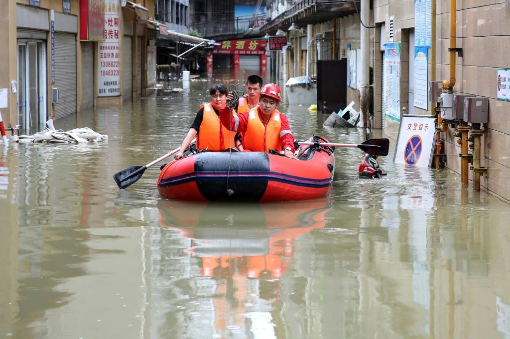 Rescuers evacuate flood-affected residents in Neijiang in Sichuan province