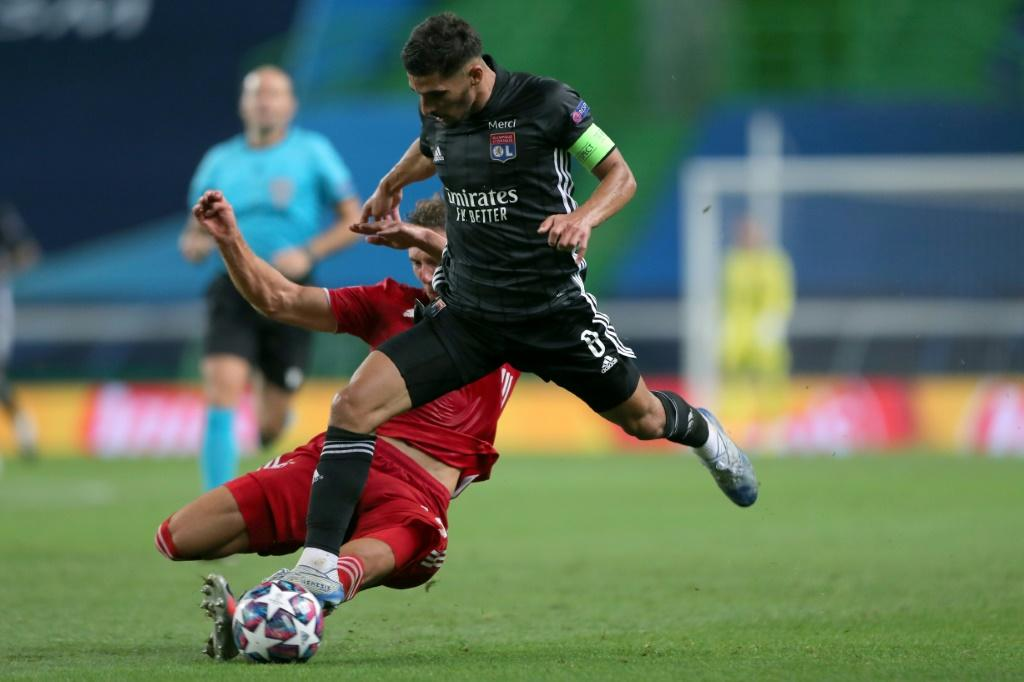 Houssem Aouar in action against Bayern Munich. He is one of those players who could well now be sold by a Lyon side deprived of Champions League football in the new season
