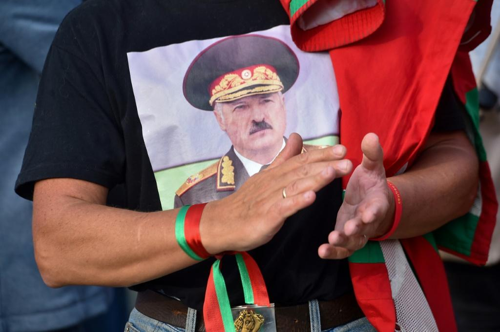 An admirer shows support for President Lukashenko ahead of a major opposition rally set for Sunday