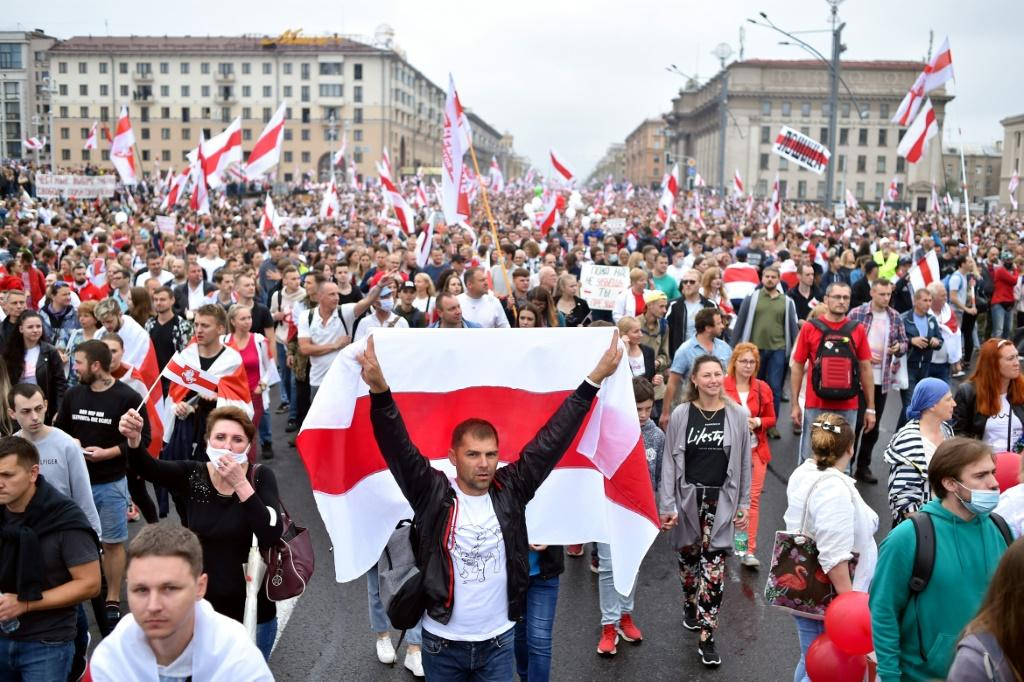 Demonstrators were draped in the red-and-white flags of the opposition