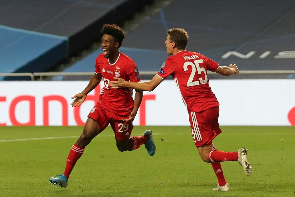 Kingsley Coman celebrates with Thomas Mueller after scoring the goal that won the Champions League final for Bayern Munich against Paris Saint-Germain on Sunday