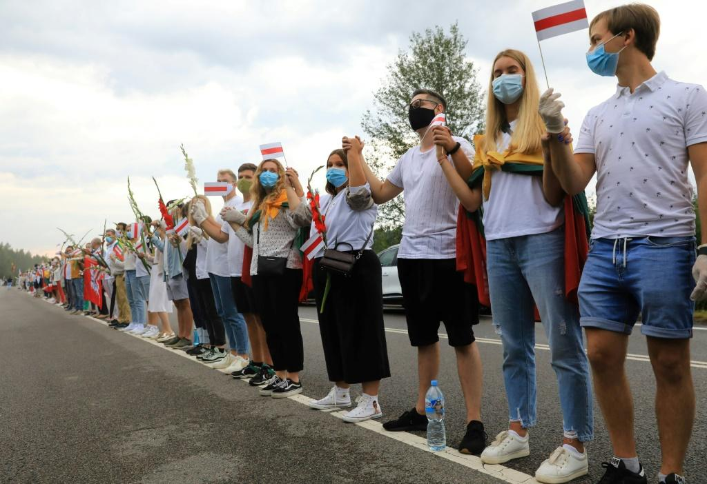 People form a human chain from Vilnius to Medininkai along the border with Belarus to show solidarity with the Belarussian people in Medininkai, Lithuania