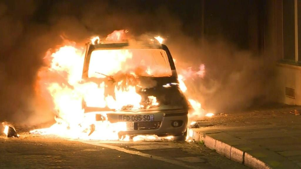 A car is set on fire and a shop near the Champs-Elysees is looted after the Champions League final as some Paris Saint-Germain fans are angered by their team's defeat in Lisbon.