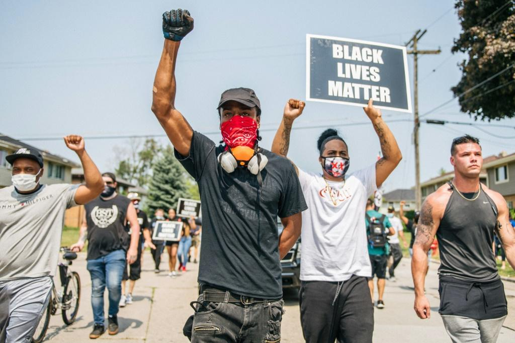 Demonstrators participate in a march on August 24, 2020 in Kenosha, Wisconsin over the shooting of Jacob Blake by police
