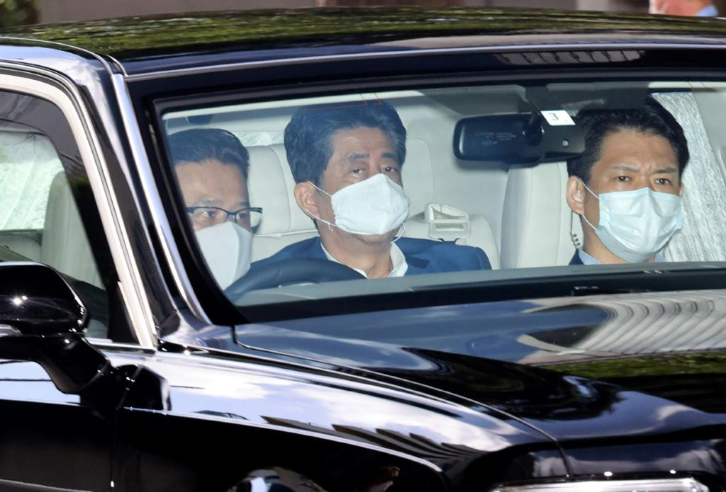 Japan's Prime Minister Shinzo Abe was back in hospital for additional tests a week after a surprise visit that sparked speculation about his health