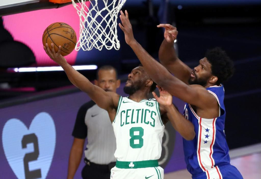 Kemba Walker of the Boston Celtics shoots against Joel Embiid of the Philadelphia 76ers during the first quarter in Game Four