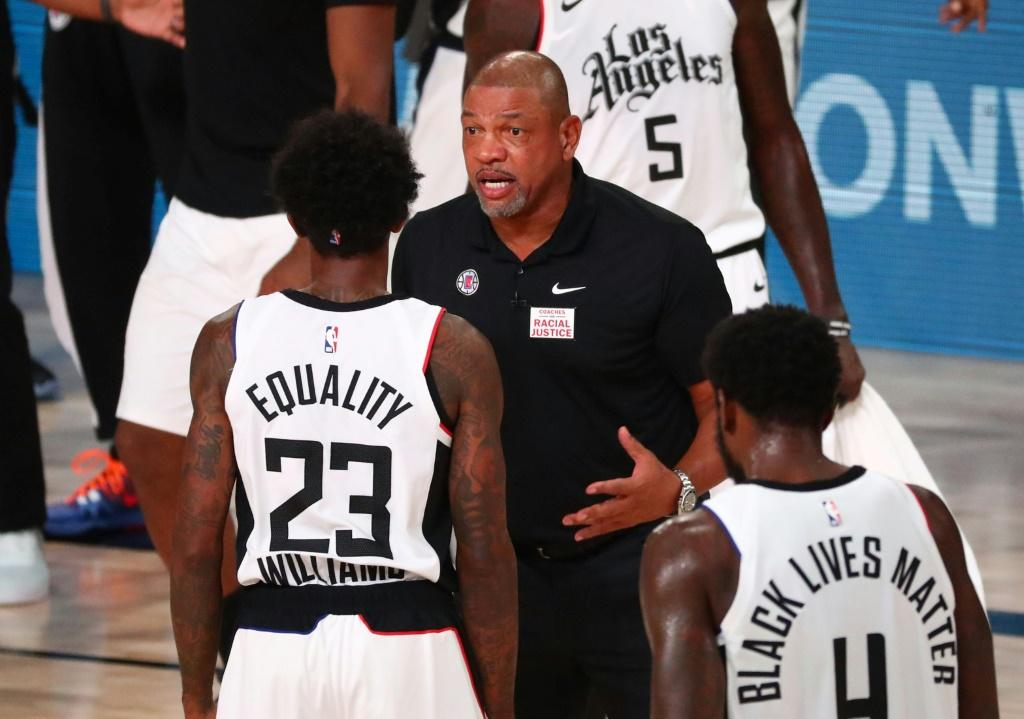 """Los Angeles Clippers coach Doc Rivers (C, pictured August 25, 2020) blasted systemic racism and police brutality in the US, saying, """"It's amazing to me why we keep loving this country and this country does not love us back"""
