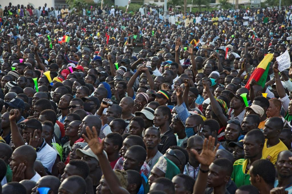 """A rally organised last Friday by a protest coalition cheered the junta for toppling Keita. Its leaders have vowed to """"work with"""" the military over returning the country to civilian rule"""