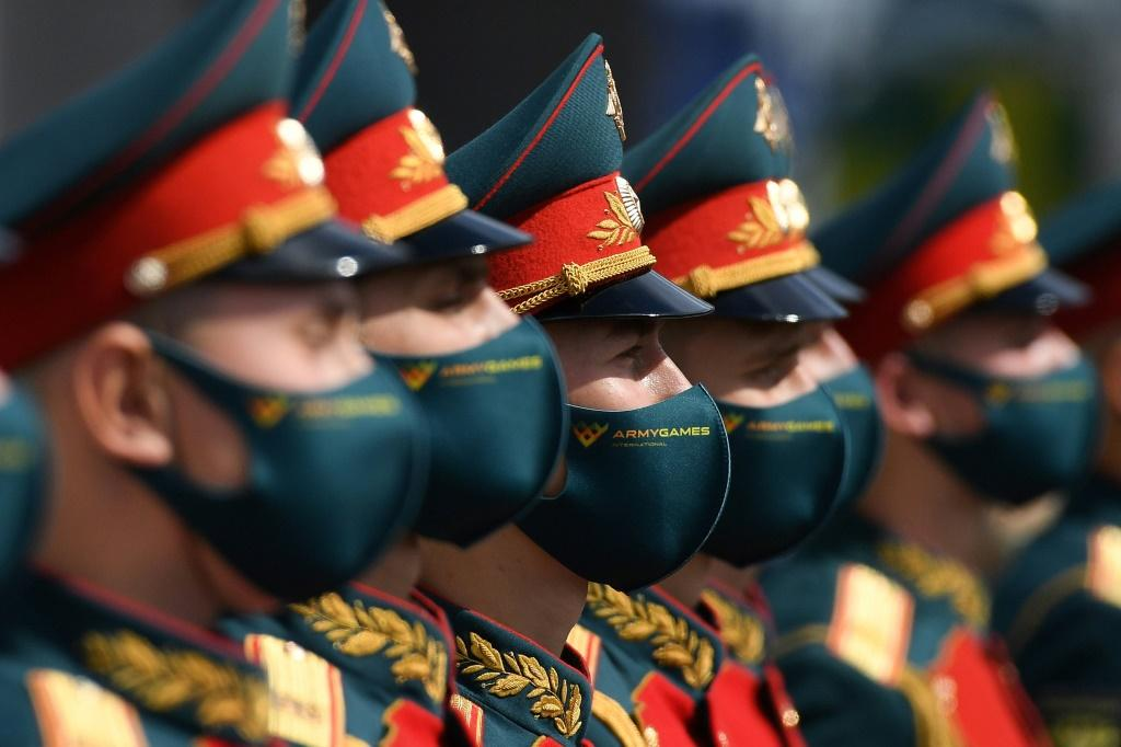 Russian President Vladimir Putin said he would hold troops ready for a potential intervention in neighboring Belarus