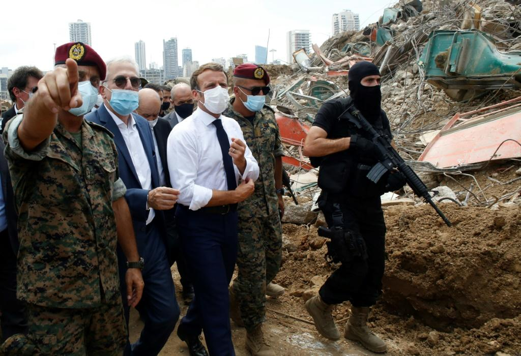 French President Emmanuel Macron visits the devastated site of the explosion at the port of Beirut on August 6