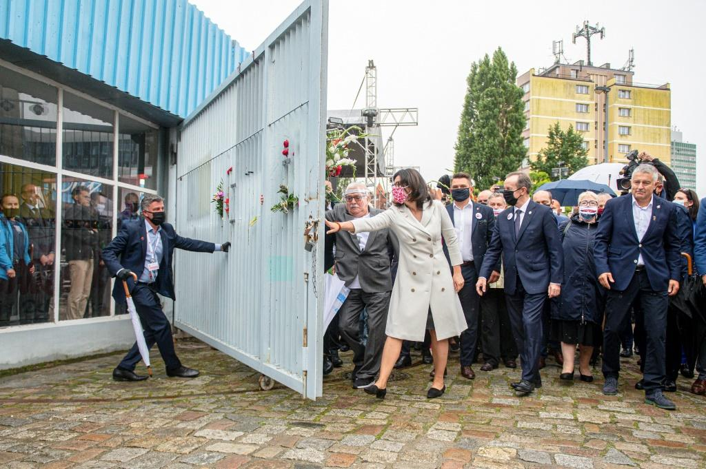 Walesa placed flowers on the shipyard gate and symbolically opened it as he did four decades ago after inking the Gdansk Accords