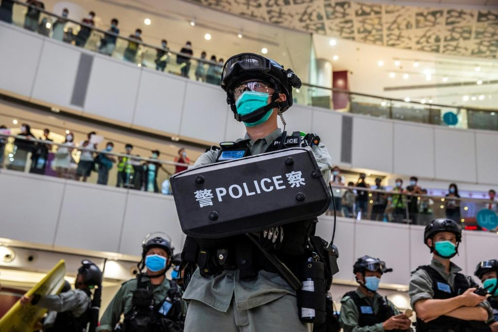 A riot police officer stands guard in a shopping mall in Hong Kong in July after the new national security law was introduced in the city
