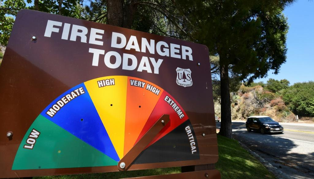 An arrow points toward Extreme Fire Danger on September 4, 2020 as a vehicle passes along the Angeles Crest Highway in the San Gabriel Mountains northeast of Los Angeles in La Canada Flintridge